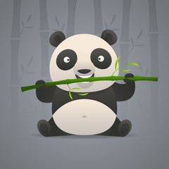 Cute panda gnaws bamboo