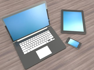 Open laptop with digital tablet and white smartphone