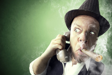 Investigator having an important phone call while smoking
