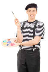 Male artist with paintbrush and a color palette