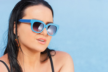 Happy woman in sunglasses on vacation
