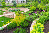 Natural landscaping in home garden - 67080687