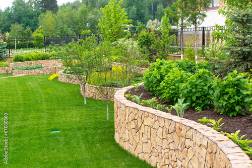 Natural landscaping in home garden - 67080660