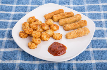 Fried Fish Sticks and Potato Puffs
