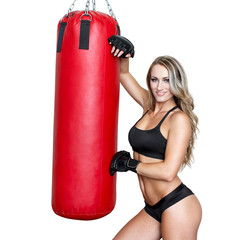 Sexy blonde woman with heavy bag