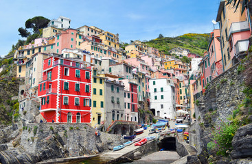 Bright houses in the village Riomaggiore. Cinque Terre