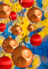 Golden Christmas balls with blur shiny background
