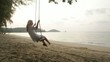 Woman on swing at tropical beach-Sunset in Island