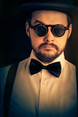 Man with Top Hat and Steampunk Glasses Retro Portrait