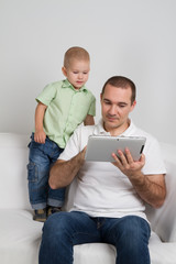 Dad and son watching tablet