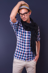 handsome young fashion man wearing scarf and hat