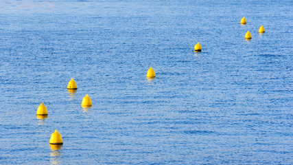 yellow buoys on water