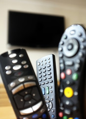 Group of TV remote controls with a TV