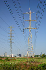 Industrial view with big electric pylons  in central israel.