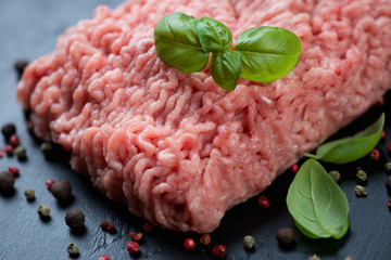 Raw turkey minced meat with spices, close-up, horizontal shot