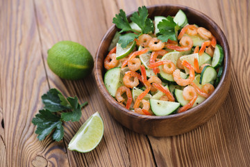 Salad with shrimps, cucumbers and lime, horizontal shot
