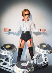 DJ girl in stockings and plays music with the plates