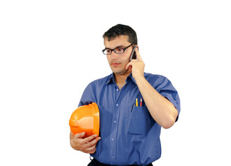 young caucasian man with construction helmet speaks on the phone
