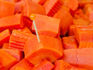 Sweet papaya fruit and toothpick