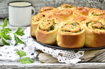 Yeast cake with cheese and herb.