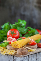 Italian ingredients - pasta, vegetables and herbs