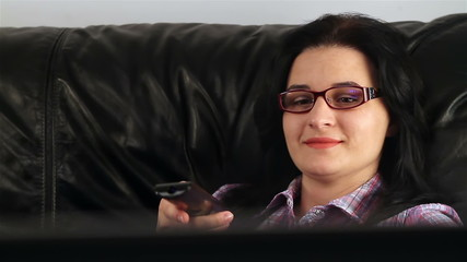 Woman with glasses  watching television