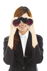 Attractive business woman with binoculars