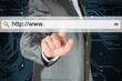 Businessman pushing virtual search bar