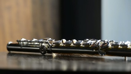 Detail of silver flutes on a wooden table