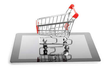 Tablet PC with shopping cart on white background.