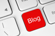 Red blog button on keyboard background .