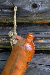 Old Ceramic Bottle On The Wall