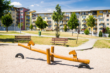 Children playground in front of row of block of flats