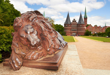 Lion statue and Holstein Gate at Lubeck. Germany