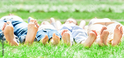 canvas print picture Family feet on grass