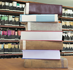 Old books in stack in scientific library