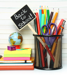 School-office stationery on book background .
