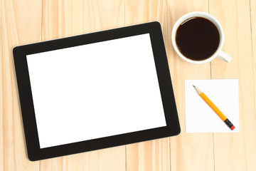 Tablet pc, cup of coffee and paper on wooden background.