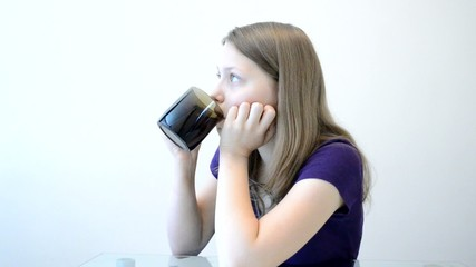 Teen girl drinking from mug
