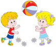 Little girl and boy playing with their big colorful ball