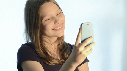 Teen girl make pictures of herself