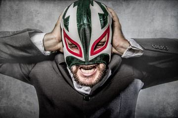 Office problems, aggressive executive suit and tie, Mexican wres