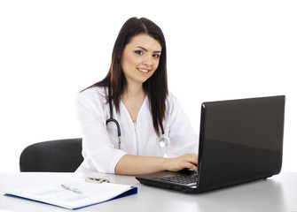 beautiful woman doctor working on a laptop and smiling