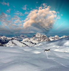 Snowy Mountains at winter sunset