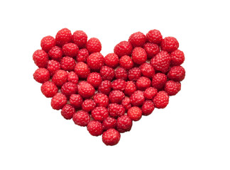 Laid raspberries in a heart shape isolated