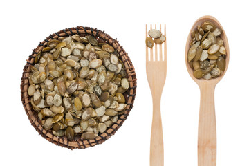 Pumpkin seed in a plate, fork and spoon