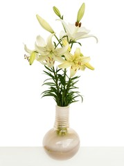 posy of white and yellow liles