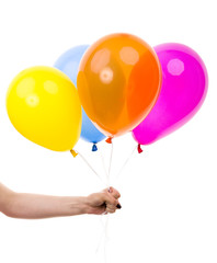 Colorful Balloons held by Female Hand. On White Background