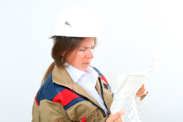 woman builder in white helmet and uniform holds a plan, project