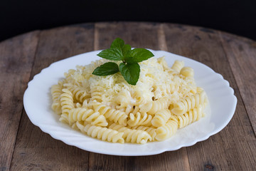 Fusilli with Creamy Sauce, Yellow Cheese and Fresh Mint Leaves